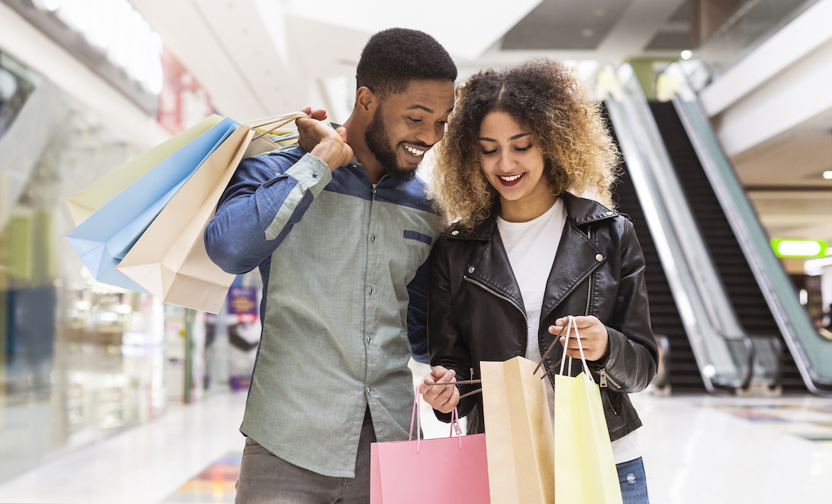 couple at the mall carrying shopping bags