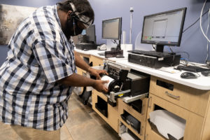 image of a technician making a repair on a printer