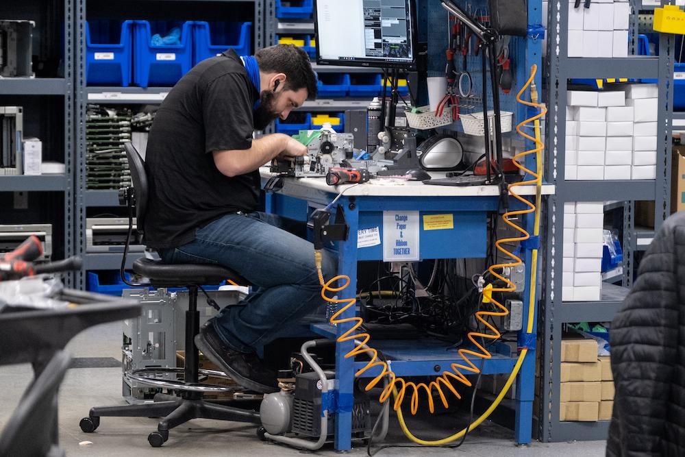 man performing a tech repair